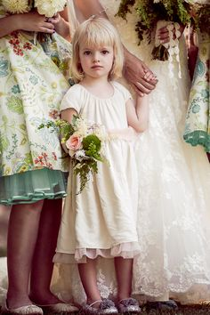 Flower girl… love the print of the bridesmaids' dresses