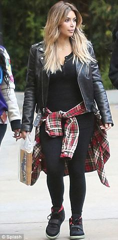 black leather jacket, black leggings, black tennies, and red plaid button up collared shirt wrapped around the waist.