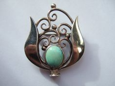 Art Nouveau / Jugendstil / Secessionist / Arts and Crafts sterling silver and turquoise brooch. Handmade. #39. View 1.