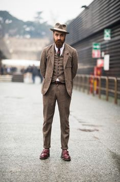 """"""" Matteo Gioli wears a Camo suit with a Super Duper hat, Eton shirt and Dr. Martens shoes. """""""
