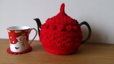 Red hand knitted tea cosy with wooden button detail  by DottyKnits, £16.00