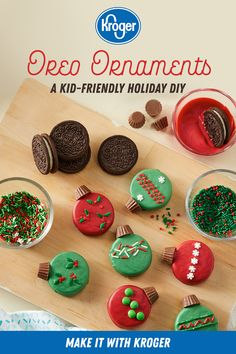 Oreo Ornaments Turn your favorite sandwich cookie into a holiday masterpiece. Decorate Oreo Double Stuf cookies with candy melts, miniature peanut butter cups and assorted sprinkles. Get the directions for this fun holiday DIY from Kroger. Christmas Party Food, Christmas Sweets, Christmas Cooking, Christmas Goodies, Christmas Cookies Simple, Christmas Treat Gifts, Christmas Party Treats For Kids, Christmas Candy Crafts, Christmas Meals