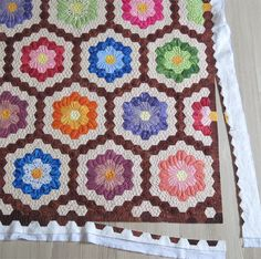 All her life, my mother made wonderful knitted clothes for her 4 daughters. Last year, me and my 3 sisters decided that it is our turn to make something for her. So we started a Grandmother's Flower Garden Quilt. My sisters are not quilters but all of them were happy to learn how to sew …