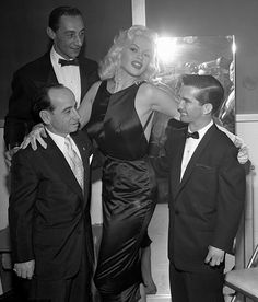 Jayne Mansfield with jockeys Johnny Longden, Eddie Arcaro and Willie Shoemaker at Jockeys' Ball in Los Angeles, Calif. 1957