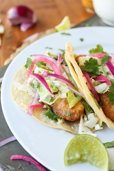 Beer Battered Fish Tacos by The Food Charlatan. These Rubio's knock-off Beer Battered Fish Tacos are tender and crunchy and worth every speck of oil! The pickled onions! The coleslaw! The crispy fish! Fish Recipes, Seafood Recipes, Mexican Food Recipes, Cooking Recipes, Healthy Recipes, Mexican Dishes, Beer Battered Fish Tacos, Tacos And Burritos, Easy Weeknight Meals