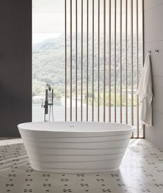 Our 'Chic' solid surface freestanding bath is a stylish, sophisticated design that quickly becomes a focal point in any bathroom. With a smooth texture and excellent heat-retention properties, solid surface material is easy to maintain and stain resistant. Available now in sizes 16ocm and 180cm. #solidsurface #bathroomdecor #modernbathrooms #freestandingbath Claw Foot Bath, Solid Surface, Modern Bathroom, Decor Styles, Freestanding Bath, Bathtubs, Pure Products, Chic, Smooth