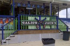 "Calico Jack's Bar and Grill, West Bay Road, Grand Cayman. ""A busy beach bar with beautiful sunsets, great events and entertaining staff."