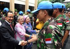 Presidential Adviser on the Peace Process, welcome the 15-man Indonesian contingent to the International Monitoring Team (IMT) at the Indonesian embassy in Manila on July 1, 2012.