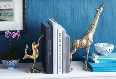 Stylist tip: Try mix-and-match brass animals as bookends.