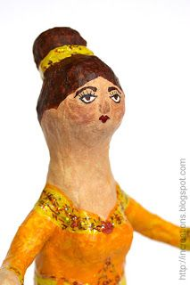 papier mache doll from a plastic bottle