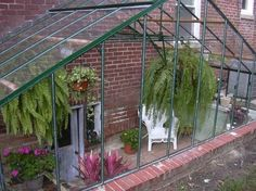 A greenhouse over the entrance to a basement.  This would be great for a protecting the stairs of a walk-up basement from the weather.                                                                                                                                                                                 More