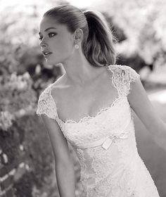 beautiful lace wedding dress with sleeves. I really really like this dress, it's perfect! I even like the ponytail with it.