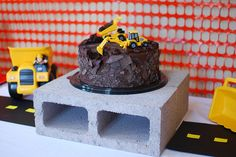 construction birthday party ideas - great idea to use the cinder blocks for lifts on food station & silt fencing for covering walls or photo booth backdrop