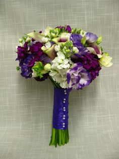 Handtied wedding bouquet of Picasso mini callas, purple and white stock, white freesia and purple  white 2 toned lisianthus.