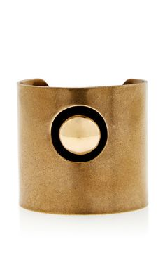 This **Tomas Maier** bracelet is rendered in brass and features a centered spherical design.