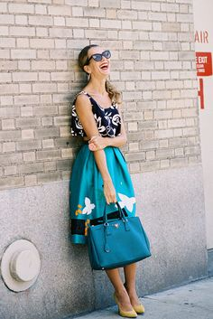 Crop tops + voluminous 50s skirts + hoop earrings + big smile // Natalie Joos via Vanessa Jackman