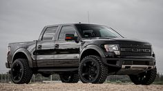 """Customized Ford F150 SVT Raptor with suspension leveling kit, 22"""" XD Rockstar wheels, and 35"""" tires."""
