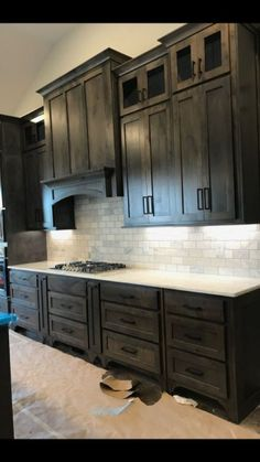 If you are looking for Black Kitchen Cabinets Design Ideas, You come to the right place. Here are the Black Kitchen Cabinets Design Ideas. Stained Kitchen Cabinets, Rustic Kitchen Cabinets, Rustic Kitchen Design, Painting Kitchen Cabinets, Home Decor Kitchen, New Kitchen, Dark Wood Cabinets, Kitchens With Dark Cabinets, Cheap Kitchen