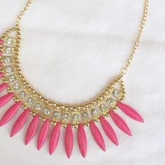 Hot pink stunning statement piece necklace Super cute statement necklace with marbled feather-like beads. Fashion jewelry, with cute rhinestone accents. Looks great with a solid shirt to really make this piece pop! ❤️Multiple in stock, please request a new listing for purchase!❤️ Jewelry Necklaces
