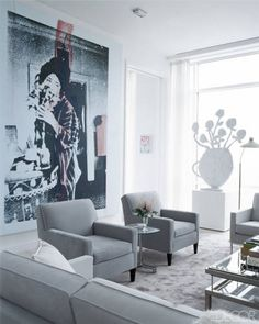 TRY: Black-and-white photography paired with a gray-and-white color scheme like JILL STUART, whose home was featured in ELLE DECOR in October 2009.
