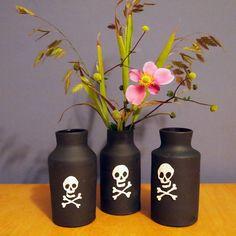 diy - make black vases with skulls for flowers on table