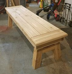 I built this bench from Cedar for a fundraiser auction. I put about $100 in wood and 8 hours of my own labor and sold it for $160... so somebody got a $260 bench. I got experience for my portfolio and the fundraiser gained $160. If you'd like to builf a bench like this or want plans for one drop me a note