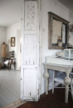 french nordic style.. love the scrollwork on the top panel of the door.