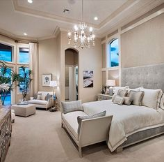DON'T install any type of light that could give off glare in the bedroom, and avoid placing a downlight directly over the bed | 7 Lighting Mistakes Rookies Make | Image courtesy of Toll Brothers featuring Progress Lighting's Noir chandelier