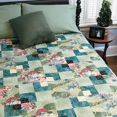 "Sea of Green  Quilt by Diane Tomlinson. Size: 89"" x 89"". Blocks: 24 (10"") blocks.    This quilt is made with simple squares and rectangles featuring a beautiful print. It's easy enough for a beginner, yet sophisticated enough for a seasoned quilter."