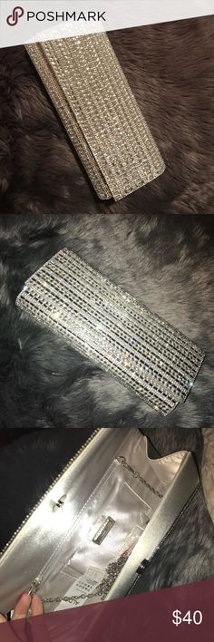 Brand new! Aldo silver rhinestone clutch! Brand new clutch from Aldo. The whole clutch is blinged out in rhinestones, super pretty! Inside is satin material with a small card holder. Comes with extra rhinestones and has its tags. Never used. Retail is $55 Aldo Bags Clutches & Wristlets