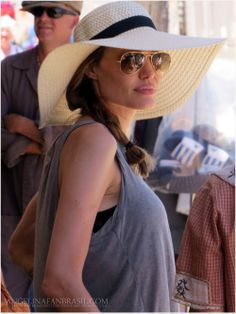 angelina jolie in casual grey tank with big straw hat