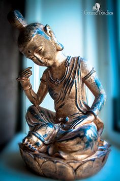 A beautiful statue of a Gold & Blue Quanyin sitting by a window sill. We stayed at a very comfortable & clean bed & breakfast called The Orchard House, close to the Alnwick Castle in Northumberland, England. If you ever go to England, make sure you visit this castle...it's a must see! Gold & Blue Quanyin ~ photography by Gracee Studios