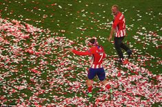 Griezmann enjoys a lap of honour amid the confetti as Atletico  celebrate their Europa Lea...