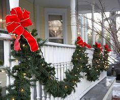 Glowing Garland  Embellish a porch or balcony with loops of garland intertwined with glowing lights. Big red bows are a welcome sight to any holiday visitor.