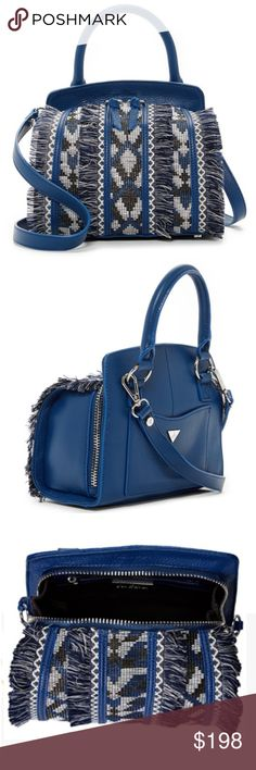 """Sam Edelman Bobbi Leather Micro Top Handle HandBag Details Fringe and a geometric pattern add a fun touch to the Bobbi Leather Handle Bag. - Single rolled top handle - Single detachable, adjustable strap - Zip around closure - Exterior features 1 slip pocket and front geo woven panel detail with fringe - Interior features 1 zip pocket and 1 slip pocket - Approx. 7.5"""" H x 8.25"""" W x 4.25"""" D - Approx. 5"""" handle drop, 22"""" strap drop - Imported Materials Leather and textile exterior, textile…"""