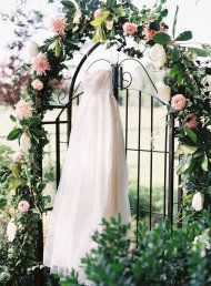 floral archway from a Texas B Wedding from Brett Heidebrecht | Style Me Pretty