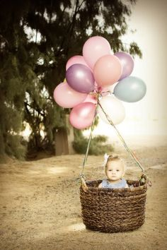 So cute! Pinned something similar over a year ago, but I have this exact basket (from Target). Would probably do more balloons & all one color to customize it. What about a white scarf and a flyer hat for an old-fashioned flier look? Hmmm...