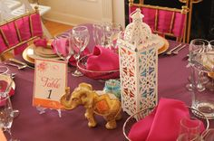 A mix of a thrift store lantern, golden elephant, and authentic Indian jar