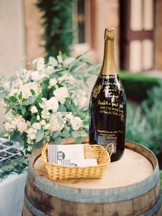 Champagne and notes to sign for guest book