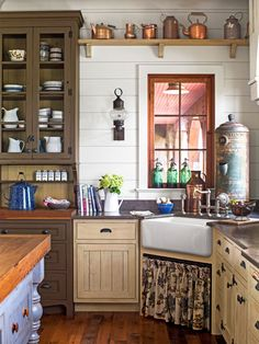 In this country kitchen, the angled placement of the apron sink may be unconventional, but its nook provides the best views of the lake. The toile fabric skirt adds softness to the handsome space.