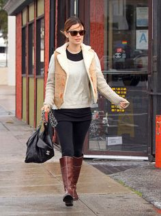 Rachel Bilson's casual-cool mix of shearling and leather riding boots works now — and will work years from now too.  Source: Getty