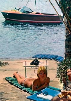 1964: Brigitte Bardot with her Riva Florida in the background