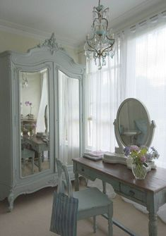 ≈ a little cleaner that what you see for shabby chic, but I LOVE the furniture here well suited are the curtains and chandelier as well ... sweet, uncluttered, chippy, pastel