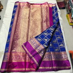 PRATYUSHA BANARASI BLACK SOFT SILK COTTON SAREE WITH DEER N ELEPHANT BUTTIS AT JUST 2100/- PLUS SHIPPING. TOP QUALITY PRODUCT WITH RICH PALLU N CONTRAST BLOUSE Order what's app 7093235052 Blue Silk Saree, Silk Cotton Sarees, Indian Designer Wear, Saree Collection, Saree Wedding, Saree Blouse, Indian Dresses, Indian Wear, Blouse Designs