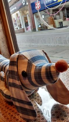 "Morna, our Leatherhead shop's Assistant Manager, made this beautiful sausage dog draft excluder, ""Schnitzel."""