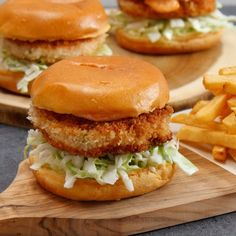 If you like popcorn shrimp, you'll love this recipe for Crispy Shrimp Burgers. Seriously, this dish is like fried shrimp on steroids.It's so simple frying this on your stove, and the simple slaw and chili mayo add a nice tang that just Burger Recipes, Fish Recipes, Seafood Recipes, Cooking Recipes, Healthy Cooking, Recipies, Vegan Recipes, Crab Burger, Shrimp Burger