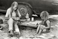 """""""Cornett family, Kentucky, 1972. Girls playing with Barbie dolls next to parked car."""" More members of the Cornett clan and its fleet of vehicles. William Gedney Photographs and Writings Collection, Duke University."""