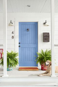 Nothing sets a sunny, welcoming tone like a bold front door accented with equally inviting country elements. Try one of these easy makeover ideas this weekend. Front Door Paint Colors, Painted Front Doors, Front Door Design, Exterior Entry Doors, Interior Barn Doors, Iron Front Door, Front Door Makeover, Barn Lighting, Exterior House Colors