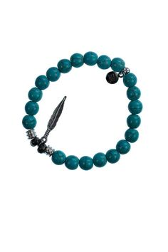 """This bracelet is accented with two Pyrite stones worn to bring good luck and good fortune to the wearer. Bracelet has an expandable band.    Measures: 2.5"""" diameter   Turquoise Feather Bracelet by T. Jazelle. Accessories - Jewelry - Bracelets Cleveland, Ohio"""