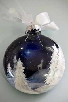 Blue Christmas Ornament White Reindeer Deer Starry Night Snowy Winter Scene Pine Forest Unique Holiday Artistic Hand Painted Gift Seasonal This little ornament is created in a way that it appears 3D. Be mesmerized while you gaze into a beautiful starry winter scene! The ornament pictured is hand painted on a 3 glass disc. The rolling snowy hills and wandering buck is painted on one side while white winter pearly pines are dropped into the foreground to create depth. Each ornament is hand…